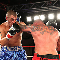 Nick Ianuzzi (red shorts) fights Mike Bisset during a Telemundo boxing match at the A La Carte Pavilion  on Friday, August 1, 2014 in Tampa, Florida. (AP Photo/Alex Menendez)