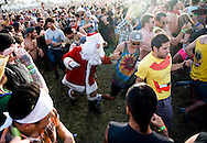 A man wearing a Santa suit joins in the mosh pit fun during Social Distortion's set on the third day of the 2013 Coachella Valley Music and Arts Festival in Indio, Calif. Sunday..