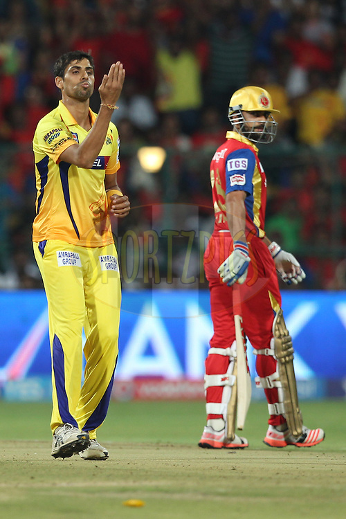 Ashish Nehra of The Chennai Superkings celebrates the wicket of Rilee Rossouw of the Royal Challengers Bangalore during match 20 of the Pepsi IPL 2015 (Indian Premier League) between The Royal Challengers Bangalore and The Chennai Superkings held at the M. Chinnaswamy Stadium in Bengaluru, India on the 22nd April 2015.<br /> <br /> Photo by:  Deepak Malik / SPORTZPICS / IPL