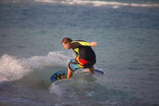 4/1/13---Miami Beach, Florida---Photo by Angel Valentin<br /> Martin Farkas while skim boarding on Miami Beach.