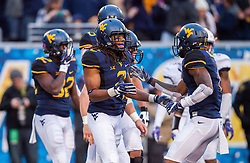 Oct 22, 2016; Morgantown, WV, USA;  West Virginia Mountaineers wide receiver Ka'Raun White (2) celebrates with teammates after catching a touchdown during the third quarter against the TCU Horned Frogs at Milan Puskar Stadium. Mandatory Credit: Ben Queen-USA TODAY Sports
