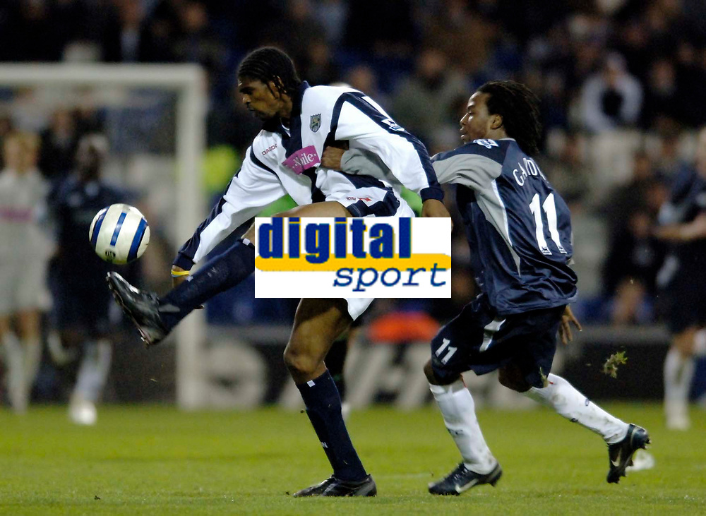 Photo: Glyn Thomas.<br />West Bromwich Albion v Bolton Wanderers. The Barclays Premiership. 17/04/2006.<br /> Bolton's Ricardo Gardner (R) and West Brom's Kanu.