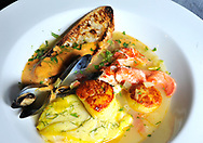"WOODS HOLE -- 081313 -- The local fish and shellfish bouillabaisse featured lobster, scallops and mussels in a saffron tomato broth served with grilled bread topped with rouille for the Celebrity Chef Tour dinner series, ""Starry, Starry Night,"" a farm-to-table dinner with Chef Cal Peternell from Chez Panisse in Berkeley, Calif., Quicks Hole chef Stephanie Mikolazyk and New York, N.Y.-baed Chef Anna Koval at Woods Hole Inn.  Cape Cod Times/Christine Hochkeppel"