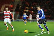 Lee Novak of Chesterfield FC goes up against Craig Alcock of Doncaster Rovers during the Sky Bet League 1 match between Doncaster Rovers and Chesterfield at the Keepmoat Stadium, Doncaster, England on 24 November 2015. Photo by Ian Lyall.
