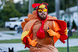 November 22, 2018 - Clearwater, Florida, U.S. - Dressed in a turkey costume, ANDREW BRYANT runs in the 5k race during the annual Turkey Trot in Clearwater. A turkey trot is a fun run or footrace, usually of the long-distance variety, that is held on or around Thanksgiving Day in the United States. (Credit Image: © Bronte Wittpenn/Tampa Bay Times via ZUMA Wire)