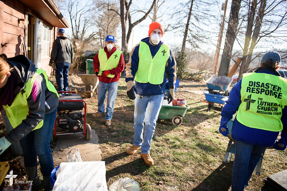 Josh Merseal in LCMS Information Technology joins other volunteers from the International Center of The Lutheran Church–Missouri Synod, LCMS Disaster Response, New Beginnings Lutheran Church in Pacific, Mo., and Missouri representatives of the Southern Baptist Convention Disaster Relief, during a cleaning event at a flooded home in Fenton on Thursday, Jan. 14, 2016. LCMS Communications/Erik M. Lunsford