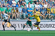 (R) Sokratis Papastathopoulos of Dorussia Dortmund controls the ball during international friendly soccer match between WKS Slask Wroclaw and BVB Borussia Dortmund on Municipal Stadium in Wroclaw, Poland.<br /> <br /> Poland, Wroclaw, August 6, 2014<br /> <br /> Picture also available in RAW (NEF) or TIFF format on special request.<br /> <br /> For editorial use only. Any commercial or promotional use requires permission.<br /> <br /> Mandatory credit:<br /> Photo by &copy; Adam Nurkiewicz / Mediasport