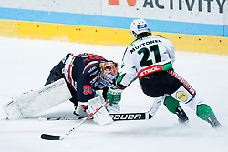 Ondrej Kacetl (HC Znojmo Orli, #90) covers a puck and Tomi Mustonen (HDD Tilia Olimpija, #21) during ice-hockey match between HC Orli Znojmo and HDD Tilia Olimpija in 16th Round of EBEL league, on October 28, 2011 at Zimni stadion, Znojmo, Czech Republic. (Photo By Matic Klansek Velej / Sportida)