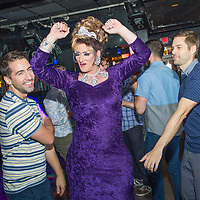 Female impersonator Allen Cole, the reigning Miss Gay Oregon XLII, dances with fans at CC Slaughter's nightclub in Portland. 12:13am