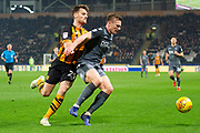 Millwall Midfielder Ben Marshall (44) battles with Hull City forward Chris Martin (29) during the EFL Sky Bet Championship match between Hull City and Millwall at the KCOM Stadium, Kingston upon Hull, England on 26 February 2019.