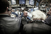 Floor brokers trade with a specialist at one of the Bank of America trading booths on NYSE minutes before closing bell.