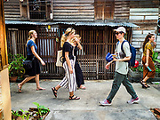 16 MAY 2017 - BANGKOK, THAILAND: Tourists walk through Pom Mahakan. The final evictions of the remaining families in Pom Mahakan, a slum community in a 19th century fort in Bangkok, have started. City officials are moving the residents out of the fort. NGOs and historic preservation organizations protested the city's action but city officials did not relent and started evicting the remaining families in early March.           PHOTO BY JACK KURTZ