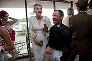 COURTNEY LOVE; FRANKIE DETORI;  IN THE DUKE OF RICHMOND BOX, Glorious Goodwood. Ladies Day. 28 July 2011. <br /> <br />  , -DO NOT ARCHIVE-© Copyright Photograph by Dafydd Jones. 248 Clapham Rd. London SW9 0PZ. Tel 0207 820 0771. www.dafjones.com.