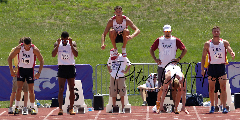 Ryan Olkowski of the United State (C) gets loose for the 100-meter dash, at the Nike Combined Events Challenge at the R.V. Christian Track Complex on the campus of Kansas State University in Manhattan, Kansas, August 5, 2006.