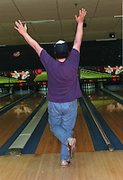 -Malden, Ma.--Town Line Lounge--Glow-In -The Dark -bowlers--Jeff 'The Hammer' Wing shows his enthusiasm after  bowling a strike during Friday night Glow-In -The Dark -bowling. (reporter-Beth DaleyRESTRICTED USE.NOT FOR REPBULICATION WITHOUT EXPLICIT APPROVAL FROM DIRECTOR OF PHOTOGRAPHYRESTRICTED USE.NOT FOR REPBULICATION WITHOUT EXPLICIT APPROVAL FROM DIRECTOR OF PHOTOGRAPHY
