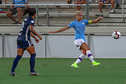 Manchester City defender Steph Houghton (6) kicks the ball away from North Carolina Courage midfielder Debinha (10) during an International Champions Cup women's soccer game, Thurday, Aug. 15, 2019, in Cary, NC. The North Carolina Courage defeated Manchester City Women 2-1.  (Brian Villanueva/Image of Sport)