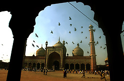 Muslims walk around the Jamia Masjid, or Grand Mosque, the first day of the Muslim Eid al-Fitr holiday marking the end of the holy month of Ramadan in Delhi, India December 17, 2001.  (Getty Images/ Ami Vitale)