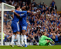 Photo: Daniel Hambury.<br />Chelsea v Manchester City. The Barclays Premiership. 20/08/2006.<br />Chelsea's Didier Drogba (R) celebrates his goal with Wayne Bridge. 3-0.