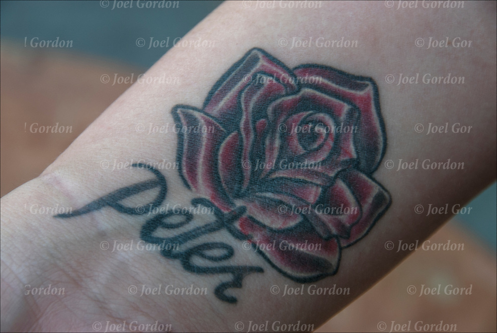 In memory of loved one, rose tattoo on  inside right arm above her wrist for her brother Peter who died at 20.  The  five rose leaves represents each of her other living brothers.<br /> <br /> Body art or tattoos has entered the mainstream it is known longer considered a weird kind of subculture.<br /> <br /> &quot;According to a 2006 Pew survey, 40% of Americans between the ages of 26 and 40 have been tattooed&quot;.