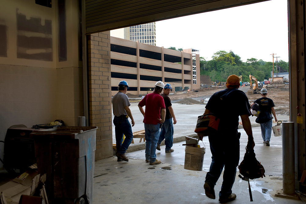 Contractors leave the Consol Energy Center in Pittsburgh at the end of their shift. The Center is scheduled to open in August.