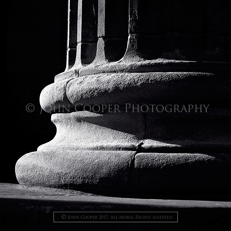 Black and White photograph of Corinthian Column Base in Glasgow. Mounted print available to purchase.