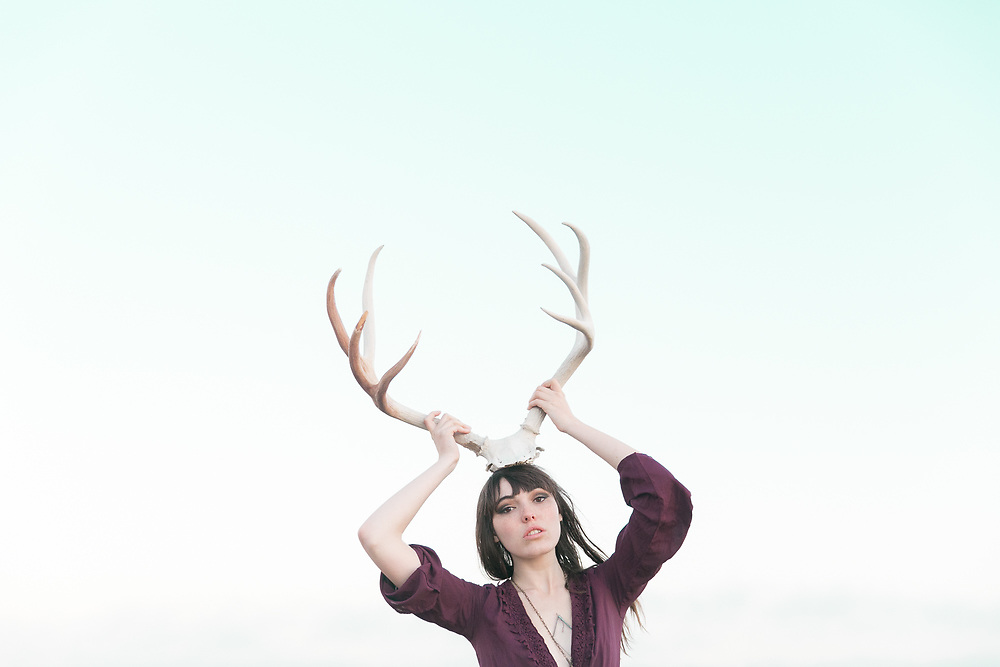 This series aims to evoke strong emotion from my subjects as they pose with this symbol of power from a dead deer.