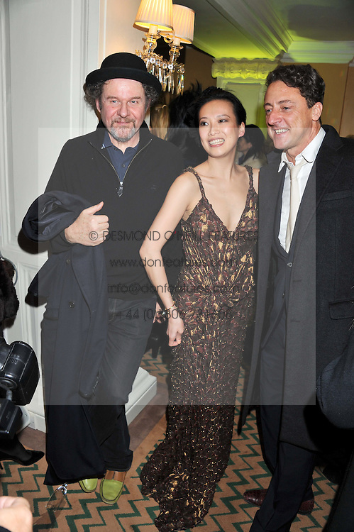 Left to right, MIKE FIGGIS, ROSIE CHAN and JEREMY HEALY at the unveiling of the Claridge's Christmas tree 2011 designed by Alber Elbaz for Lanvin held at Claridge's, Brook Street, London on 5th December 2011.