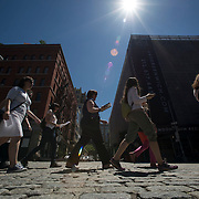"""June 21, 2014 - New York, NY : <br /> The city was flooded with music on Saturday as Make Music New York brought more than 1,300 free concerts to the city's streets and parks. The annual festival's program included """"And Death Shall Have No Dominion,"""" a piece by composer Pete M. Wyer, honoring the centenary of the birth of the poet Dylan Thomas. The piece -- a participatory singing event -- was performed by a synchronized headphone choir. The choir's singers began in smaller groups around lower Manhattan and culminated in a meeting in Battery Park City. The sopranos, who began their walk at Bleecker Playground in Greenwich Village, sing as they walk down Greenwich Street on their way to the meeting point in Nelson A. Rockefeller Park. CREDIT: Karsten Moran for The New York Times"""