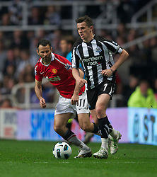 NEWCASTLE, ENGLAND - Tuesday, April 19, 2011: Manchester United's Ryan Giggs and Newcastle United's Joey Barton during the Premiership match at St James' Park. (Photo by David Rawcliffe/Propaganda)