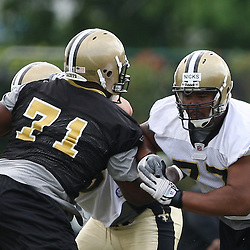 2008 May 21: New Orleans Saints rookie offensive lineman Carl Nicks #77 works against defensive tackle Kendrick Clancy during team organized activities at the Saints training facility in Metairie, LA. .