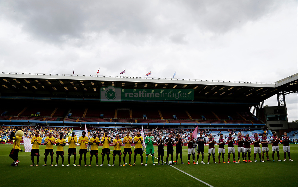 The Players observe a minutes applause before the Graham Taylor tribute match at Villa Park, Birmingham.