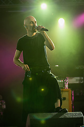 """Image ©Licensed to i-Images Picture Agency . 20/07/2014 . Henham Park , Suffolk , United Kingdom . Front man TIM BOOTH with band """" James """" performing on the 6Music Stage . The band had been scheduled to perform on the main stage yesterday (19th July 2014) but were delayed .  The Latitude Festival of music and arts . Picture by Joel Goodman/i-Images"""