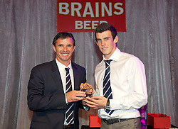 CARDIFF, WALES - Tuesday, October 4, 2011: Wales' manager Gary Speed MBE presents Gareth Bale with the Supporters' Player of the Year award at the FAW Footballer of the Year Awards 2011 held at the Wales National Museum. (Pic by David Rawcliffe/Propaganda)