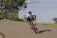 Bicyclist riding downhill on road, Mount Diablo State Park, Contra Costa County, California