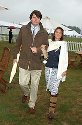 DR MARK & KATE CECIL at the 2005 Cartier International Polo between England & Australia held at Guards Polo Club, Smith's Lawn, Windsor Great Park, Berkshire on 24th July 2005.<br />