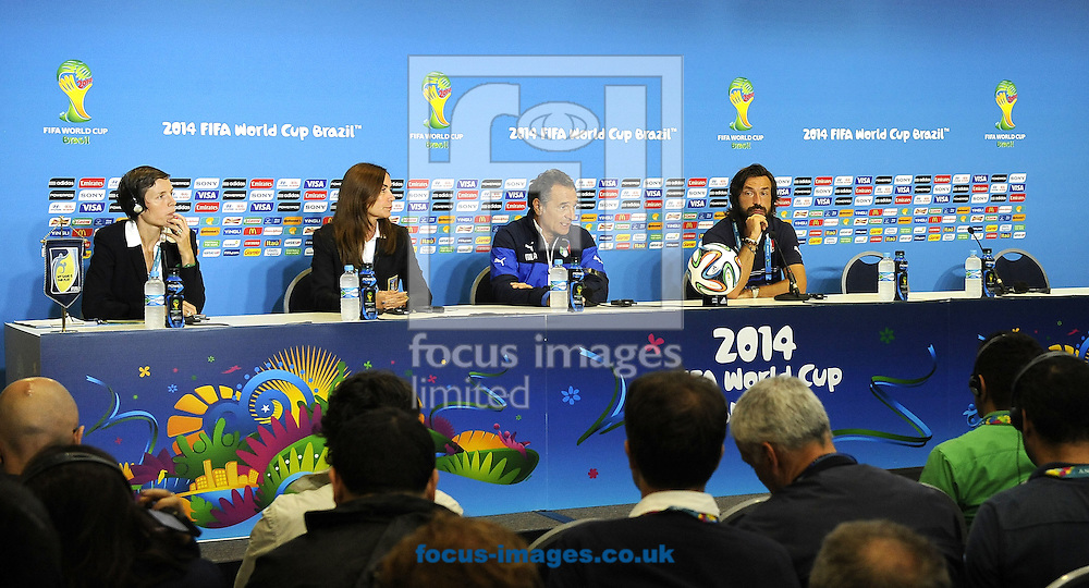 Italy captain Andrea Pirlo (right) with head coach Cesare Prandelli (2nd right) during a press conference at Arena das Dunas, Natal<br /> Picture by Stefano Gnech/Focus Images Ltd +39 333 1641678<br /> 23/06/2014
