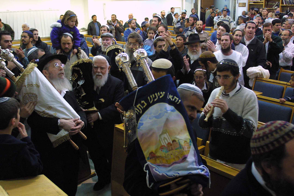Settlers celebrate with a new Torah book that they bringing in to the synagogue  ..