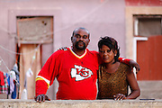 Husband and wife pose for photos outside their home. Benguela, Angola. Africa. .Pictures © Z & D Lightfoot..www.lightfootphoto.co.uk