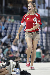 14 August 2015: Female fun crew member doing the chicken dance during a Frontier League Baseball game between the Washington Wild Things and the Normal CornBelters at Corn Crib Stadium on the campus of Heartland Community College in Normal Illinois