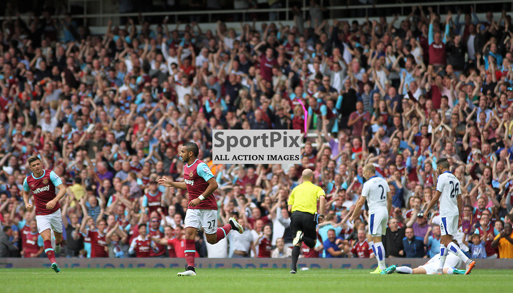Dimitri Payet celebrates whilst Upton park celebrates During West Ham United vs Leicester City on Saturday the 16th August 2015.