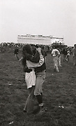 Couple embrace at the first outdoor rave up North, The Gio Goi Joy Rave run by Anthony and Chris Donnelly, Ashworth Valley, Rochdale, 5th August 1989.