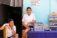 Waitresses in Niquero, Granma Province, Cuba.