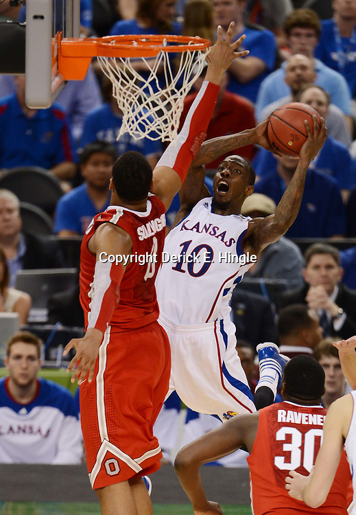 Mar 31, 2012; New Orleans, LA, USA; Kansas Jayhawks guard Tyshawn Taylor (10) goes up for a shot as Ohio State Buckeyes forward Jared Sullinger (0) defends during the second half in the semifinals of the 2012 NCAA men's basketball Final Four at the Mercedes-Benz Superdome. Mandatory Credit: Derick E. Hingle-US PRESSWIRE