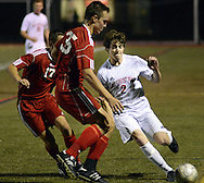 FRANCONIA, PA - NOVEMBER 11: Holy Ghost Prep's Michael Kirby #2 attempts to dribble the ball past Fleetwood defenders Kale Follweiler #17 and Matt Hook #35 in the first half of the District One Class AA semifinal soccer playoff game at Souderton High School November 11, 2014 in Franconia, Pennsylvania.  (Photo by William Thomas Cain/Cain Images)