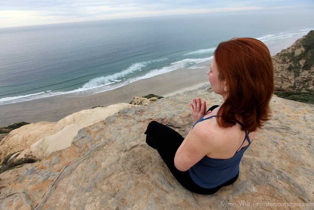 USA, California. Natural woman, 30's - 40's, in meditation outdoors.