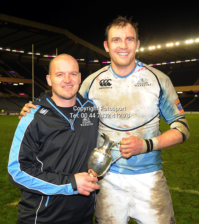 Glasgow captain Al Kellock celebrates victory with the inter-city 1872 Cup with head coach Gregor Townsend.<br /> Edinburgh Rugby v Glasgow Warriors, 1872 Cup, Murrayfield Stadium, Edinburgh, Scotland, Saturday 28th December 2012.<br /> PLEASE CREDIT ***FOTOSPORT/DAVID GIBSON***