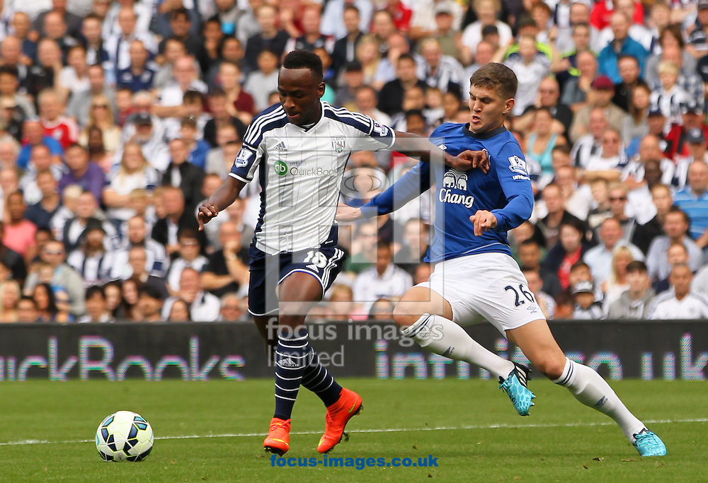 Saido Berahino (left) of West Bromwich Albion holds off S&eacute;amus Coleman (right) of Everton during the Barclays Premier League match at The Hawthorns, West Bromwich<br /> Picture by Tom Smith/Focus Images Ltd 07545141164<br /> 13/09/2014