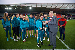 SWANSEA, WALES - Thursday, June 7, 2018: FAW President David Griffiths presents the FAW Women's Cup to Swansea City Ladies' captain Alicia Powe during the FIFA Women's World Cup 2019 Qualifying Round Group 1 match between Wales and Bosnia and Herzegovina at the Liberty Stadium. (Pic by David Rawcliffe/Propaganda)