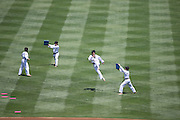 LOS ANGELES, CA - JULY 28:  The Korean National Taekwondo Team performs flying and leaping kicks for fans before the Los Angeles Dodgers game against the Cincinnati Reds on Sunday, July 28, 2013 at Dodger Stadium in Los Angeles, California. The Dodgers won the game in a 1-0 shutout. (Photo by Paul Spinelli/MLB Photos via Getty Images)