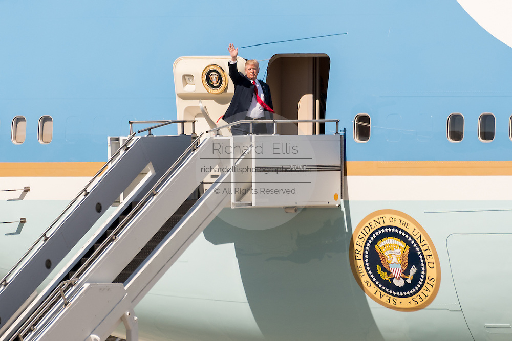 U.S. President Donald Trump waves as he boards Air Force One at the Boeing factory February 17, 2016 in North Charleston, SC. Trump was in Charleston for the rollout of the new Boeing 787-10 Dreamliner aircraft.